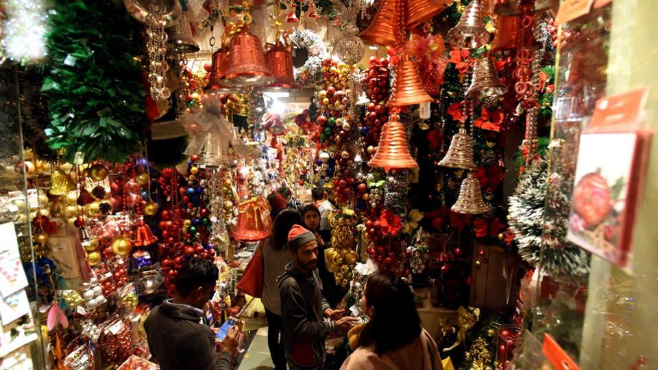 In Delhi, much of the festival food for Christmas is inspired by what's prepared for other festivals across north India. People flock to Sadar Bazar for Christmas shopping, where there are rows of shops with every kind of Christmas tree imaginable. (Amal KS / HT Photo)