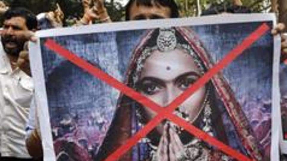 Members of a Hindu organization carry posters and shout slogans against the release of the Bollywood film