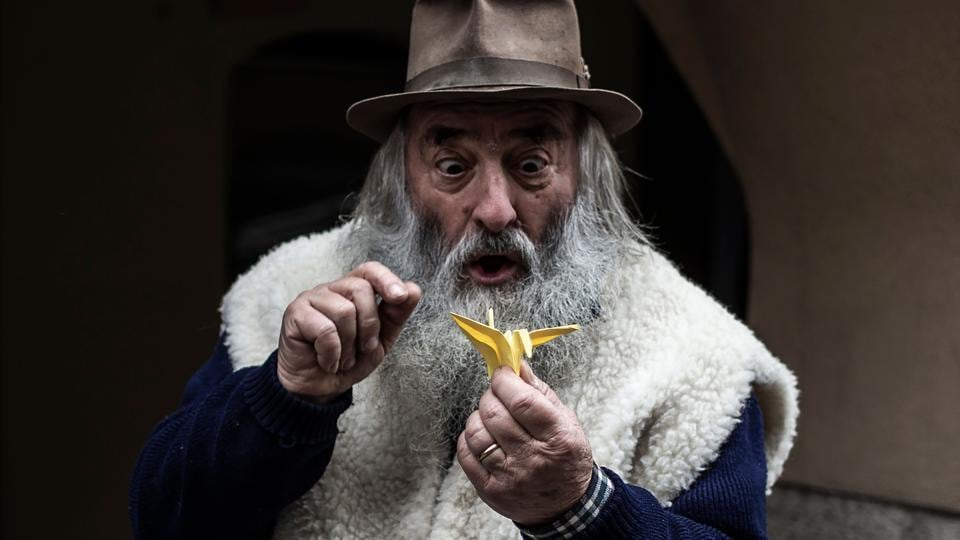 """With his portly frame, bushy white beard and twinkling eyes, Italian toymaker and puppeteer Mario Collino could be a stand-in for Father Christmas. But while he too carts around bags of toys made in his workshop, Collino, who performs under the name """"Prezzemolo"""" (Mister Parsley), is more of a Mister Geppetto, the fictional carver and father of the fairytale hero Pinocchio. (Marco Bertorello / AFP)"""