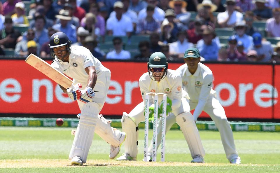India's Mayank Agarwal (L) plays a shot as Australia's Tim Paine (C) and Usman Khawaja look on during day one of the third test match between Australia and India at the MCG in Melbourne. (REUTERS)