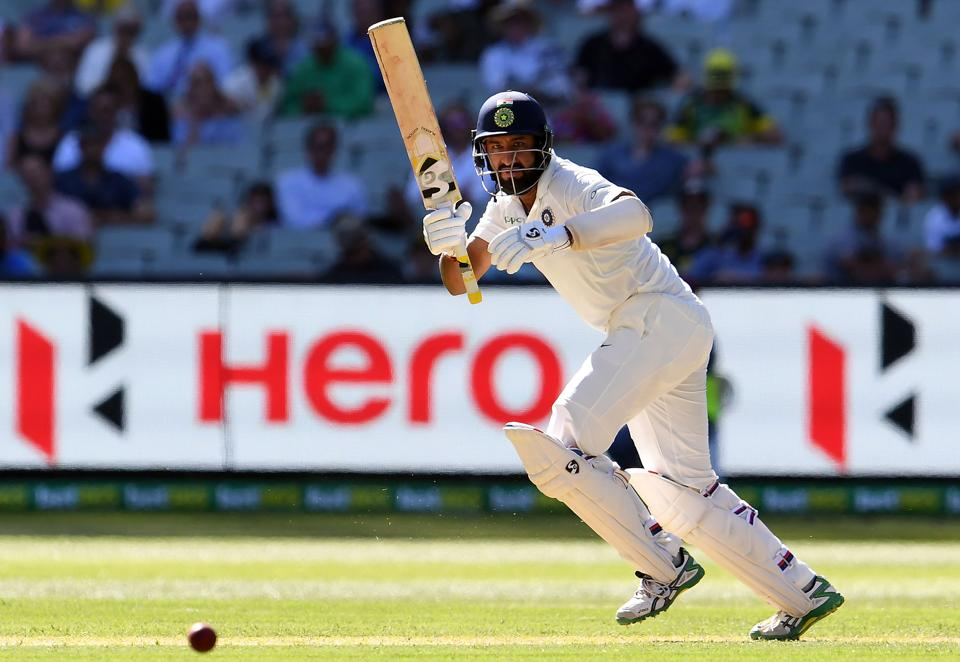 India's batsman Cheteshwar Pujara plays a shot during day one of the third cricket Test match between Australia and India in Melbourne. (AFP)