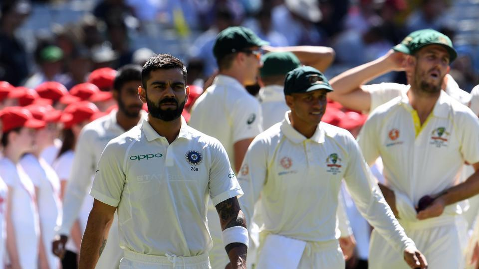 India's captain Virat Kohli (C) walks into the ground prior to play of day first of the third Test cricket match between Australia and India in Melbourne. (AFP)