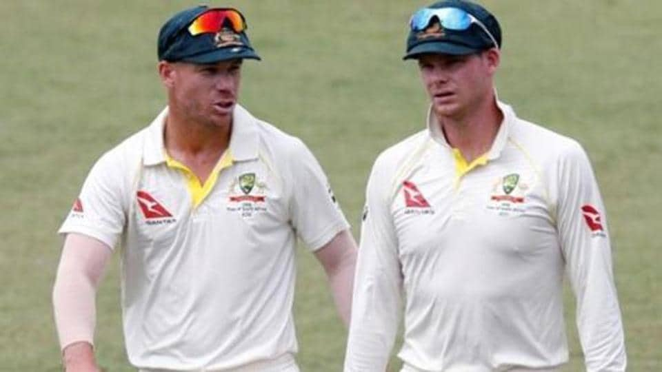 Australia's David Warner and Steve Smith leave the pitch after beating South Africa.