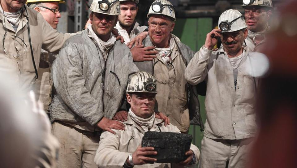Coal miners pose with the last piece of black coal at at the Prosper Haniel colliery on December 21, 2018, in Bottrop, Germany