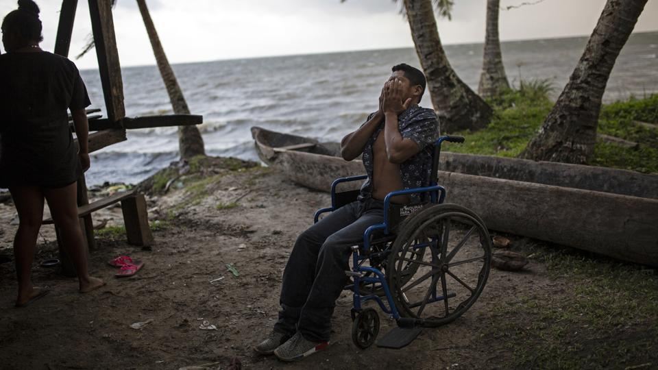 "Charly was 16 and had harvested 60 pounds of lobster on the day in November 2017 that he was injured. Even now, after nine sessions, he hasn't recovered. For a man who always made his living diving, it's a nightmare being confined to a wheelchair. ""I still can't stand up by myself,"" he said. ""I can't sit for a long time; after an hour my body hurts."" (Rodrigo Abd / AP)"