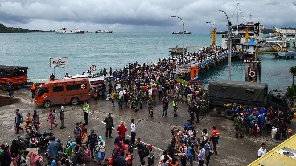 Hundreds of residents still stranded on tiny islands in Sunda Strait are being airlifted or taken by boat to shelters. Nearly 22,000 people have been evacuated and are living in shelters. (Mohd Rasfan / AFP)