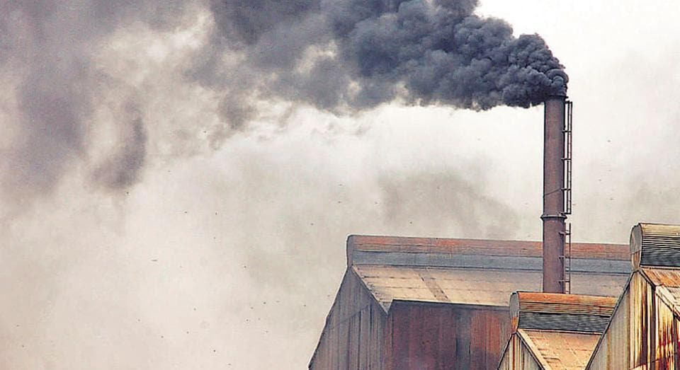 Black soot coming out of a chimney of a factory in Sahibabad Site IV Industrial Area in Ghaziabad. The city is most polluted in Delhi and NCR.