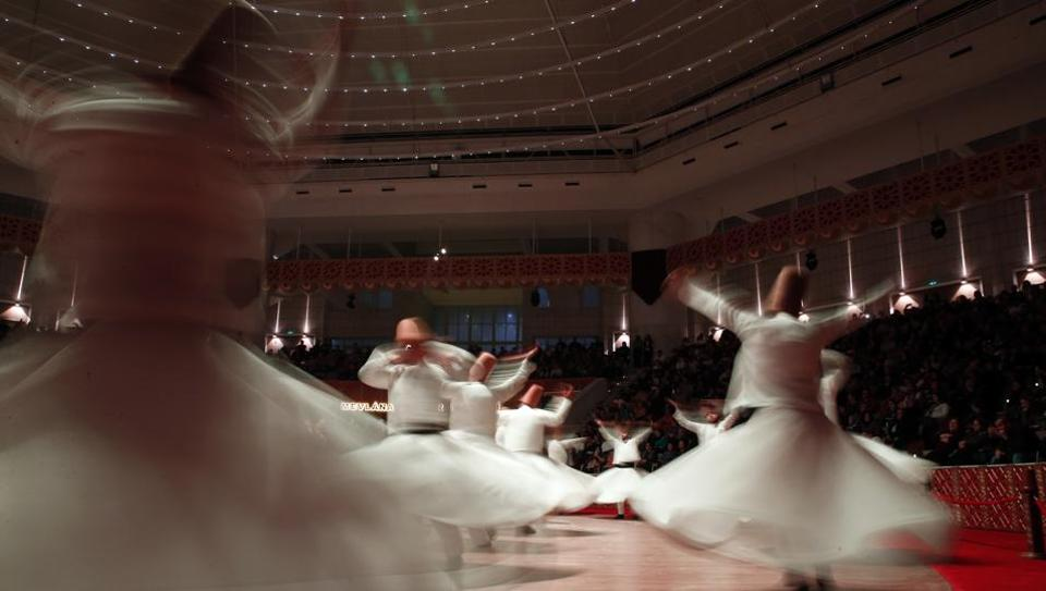Whirling dervishes of the Mevlevi order perform during a Sheb-i Arus ceremony in Konya, central Turkey. Every December, the Anatolian city hosts a series of events to commemorate the death of 13th century Islamic scholar, poet and Sufi mystic Jalaladdin Rumi. (Lefteris Pitarakis / AP Photo)