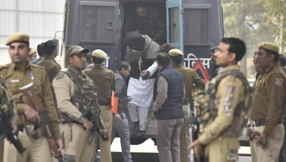 A Delhi court has sent 10 people, arrested on Wednesday for alleged links with an ISIS module, to the National Investigation Agency's custody for 12 days. They were produced in the court of Additional Sessions Judge Ajay Pandey amid tight security with faces covered. The judge had ordered in-camera proceedings in the case. (Sanjeev Verma / HT Photo)