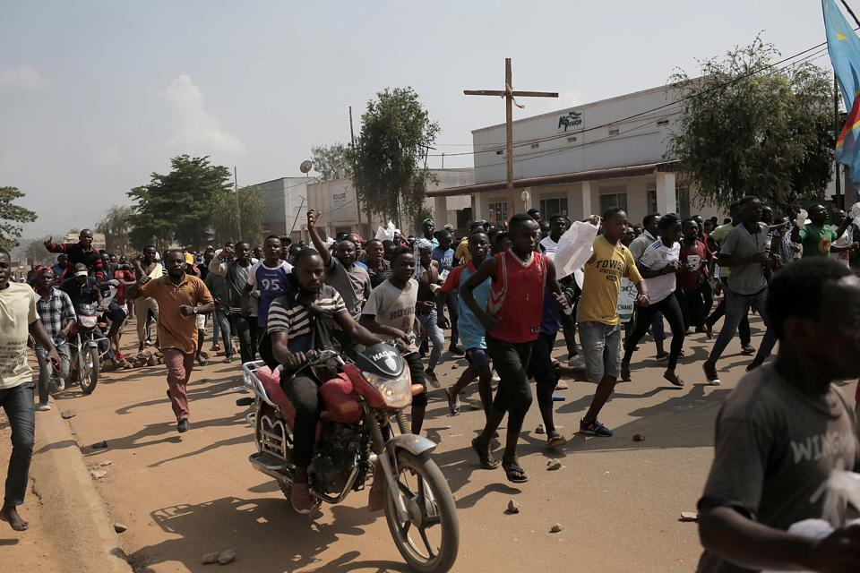 Several hundreds of people demonstrate, on December 27, 2018 in Beni, easter, Democratic Republic of Congo, to protest against the postponement of the general elections in this area because of the Ebola outbreak and the mass killings of civilians in this trouble part of DRC.