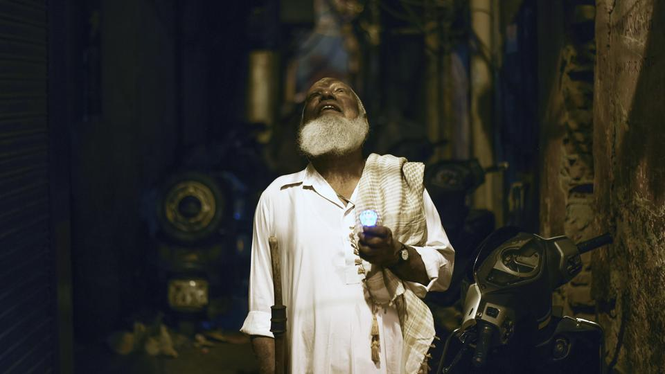 Nawabuddin, 75, or 'Peer ji', is seen roaming the streets at night to wake devotees for the pre-dawn sehri meal in the month of Ramzan in the old quarters of Delhi. Criers like Nawabuddin are a dying breed, continuing a tradition from times before the alarm clock took over. (Burhaan Kinu / HT Photo)