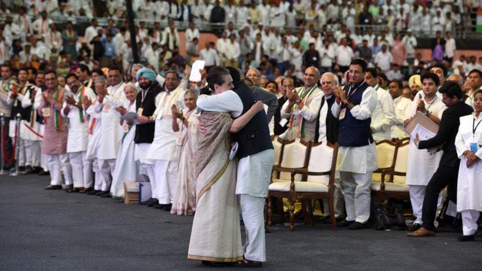 Congress President Rahul Gandhi hugs outgoing INC President Sonia Gandhi after her address during the Congress' 84th Plenary Session, at Indira Gandhi Stadium, in New Delhi. Rahul Gandhi officially took the helm of India's Grand Old Party at the event. (Mohd Zakir / HT Photo)