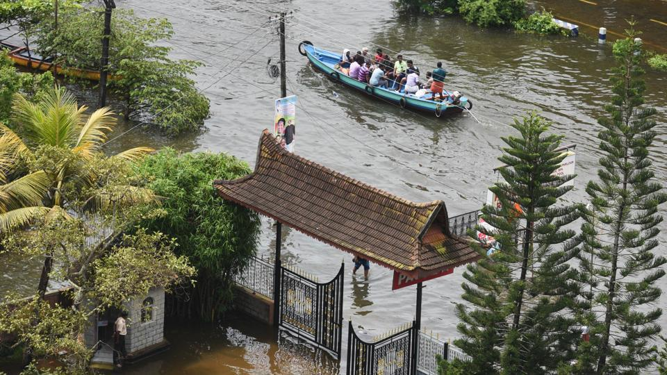 Volunteers rescue people from a flooded residential area at Alappuzha district, in Kerala. Extreme rainfall and flooding devastated Kerala in August, the worst disaster the state confronted in almost a century. A meteorological analysis of the event by the ministry of earth sciences (MoES) later concluded it as a result of climate change. (Raj K Raj / HT Photo)