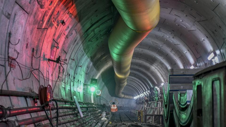 A worker during metro construction work in a tunnel at Azad Maidan in Mumbai, Maharashtra. In a major milestone in the construction of the city's first underground Metro corridor, the first tunnel of the 33.5-km Colaba-Bandra-Seepz (Metro-3 line) was completed in September. (Kunal Patil / HT Photo)
