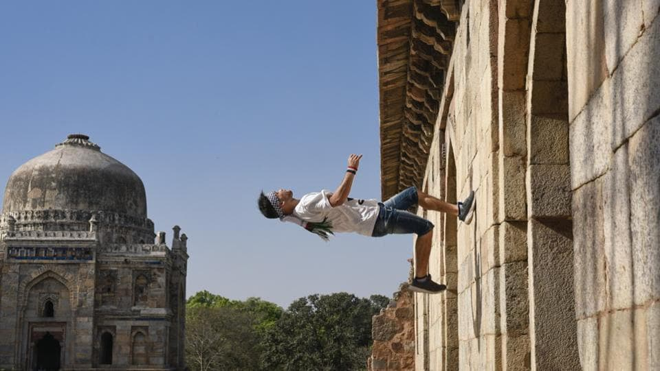 Uday Al Ajramy, a Palestinian parkour athlete and member of Free Run Gaza, an Amman based group dropped by Delhi to test the city's potential for this freewheeling sport. Ajramy is seen here scaling up a wall at the Lodhi Gardens. (Burhaan Kinu / HT Photo)