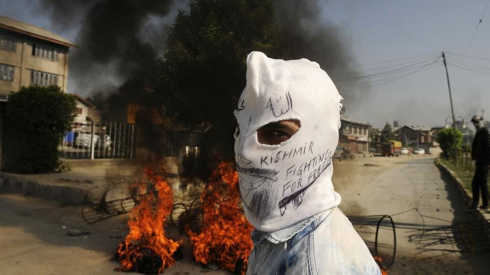 A masked protester looks on during clashes in downtown, Srinagar, Jammu and Kashmir. (Waseem Andrabi / HT Photo)