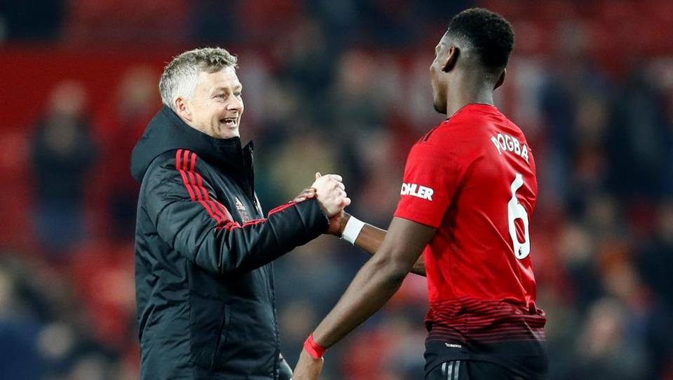 Manchester United's Paul Pogba and interim manager Ole Gunnar Solskjaer after the match