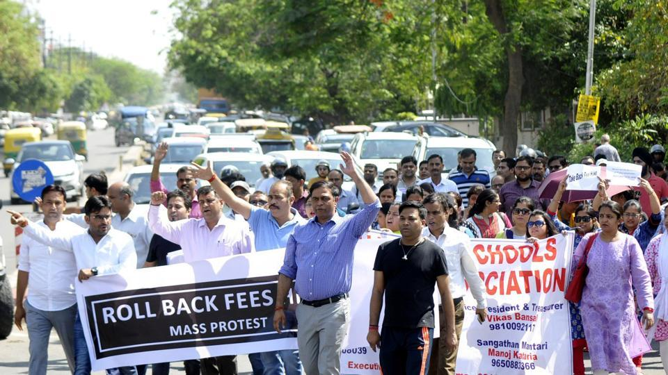 Parents association of Noida march in protest against the school over fee hike at city magistrate office, in Noida