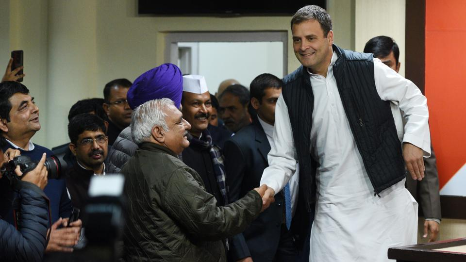 Congress President Rahul Gandhi greets senior leader Bhupinder Singh Hooda before addressing a press conference at AICC headquarter after the party's victory in assembly elections in New Delhi. The party reversed its fortunes in election held in the states of Rajasthan, Madhya Pradesh and Chhattisgarh, boosting party morale ahead of the 2019 General elections. (Mohd Zakir / HT Photo)