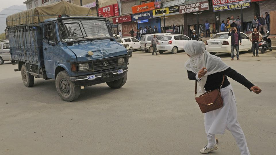 A college student pelts a stone onto a police vehicle during clashes outside a college while protesting against killings in the state, in Srinagar, Jammu and Kashmir. In countless protests against civilian killings or during demonstrations of anti-India sentiments, the participation of Kashmir girl students was a noted occurrence this year. (Waseem Andrabi / HT Photo)