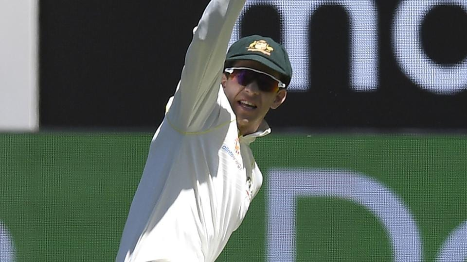 Australia's Tim Paine celebrates at the wicket of India's Mayank Agarwal during play on day one of the third cricket test between India and Australia in Melbourne.
