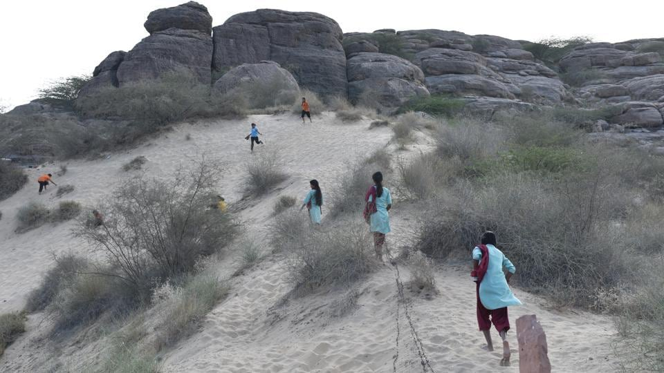 Popularly known as 'Ret ka Tila' (sand dune), girls from the Veerni Institute run up the mound in the evening after classes to play, in Jodhpur, Rajasthan. The institute offers thee girls, from diverse economic and social backgrounds, an escape from the patriarchal societal rigor. (Anushree Fadnavis / HT Photo)