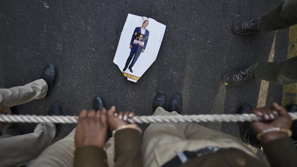 A poster of Nirav Modi lies on the ground during a protest march of the Indian Youth Congress at IYC office, in New Delhi. Modi and his uncle Mehul Choksi are accused of benefiting from a huge fraud against the Punjab National Bank, the country's second largest lender, to the tune of more than $2 billion and have been absconding. (Burhaan Kinu / HT Photo)