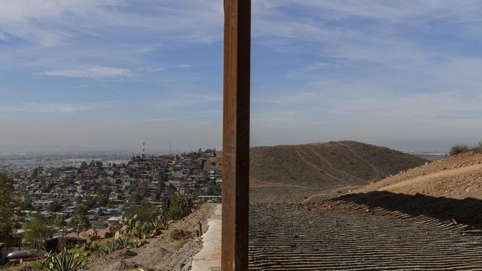 Tijuana, Mexico (L), and San Diego, California (R), are seen separated by the US border fence. The US federal government is expected to remain partially closed past Christmas Day in a protracted standoff over President Donald Trump's demand for money to build a border wall with Mexico. (Daniel Ochoa de Olza / AP)