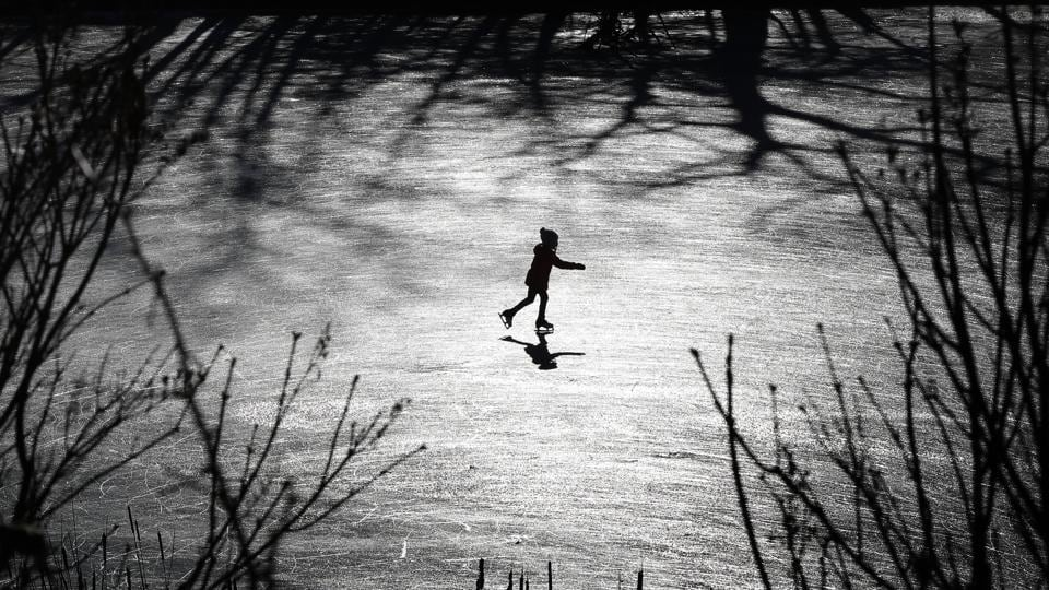 A girl skates across a frozen pond in Freeport, Maine. Last week's rain washed away much of the snow in southern Maine, but the return of cold temperatures helped create ideal outdoor skating conditions. (Robert F. Bukaty / AP)