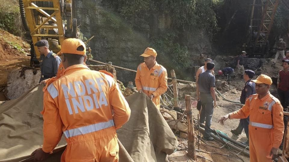 Rescuers work at the site of a coal mine that collapsed in Ksan, Meghalaya.