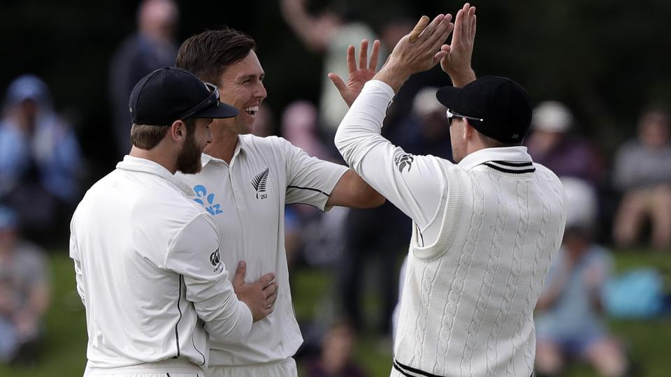 New Zealand's Trent Boult, centre, is congratulated by teammates after taking the wicket of Sri Lanka's Dimuth Karunaratne.