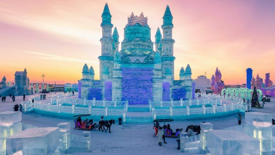 People visit the Harbin Ice-Snow World in Harbin, China's northeastern Heilongjiang province. The Harbin Ice and Snow Sculpture Festival will kick off in the city on January 4, 2019, which attracts hundreds of thousands of visitors annually. (AFP)