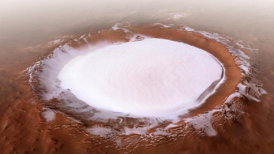 Korolev crater, in the northern lowlands of Mars. The crater is an especially well-preserved example of a martian crater and is filled not by snow but ice, with its centre hosting a mound of water ice some 1.8 kilometres thick all year round. (ESA Handout / AFP)