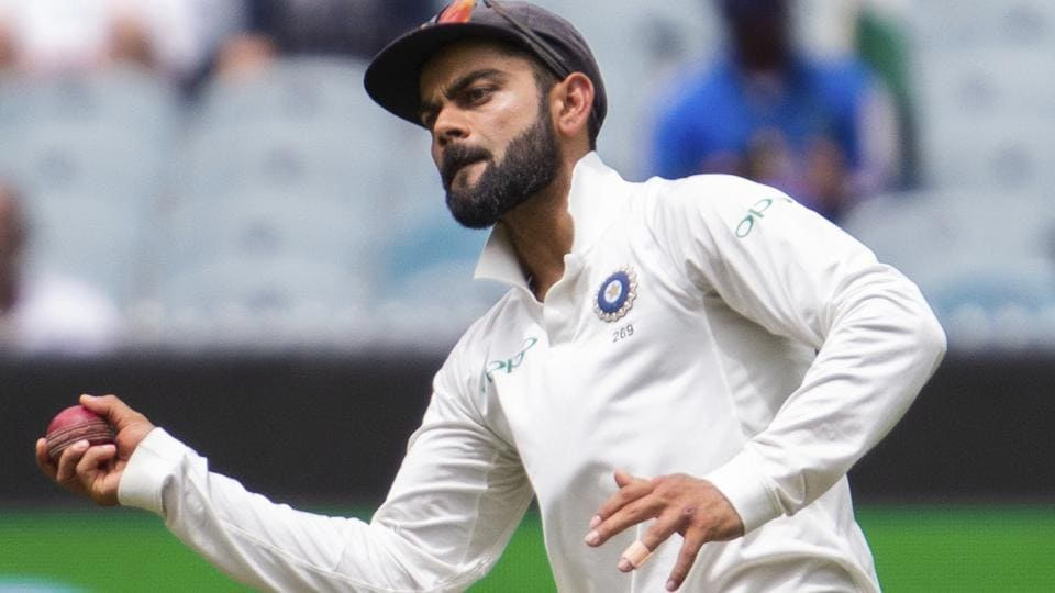 India's captain Virat Kohli throws the ball while fielding during play on day three.