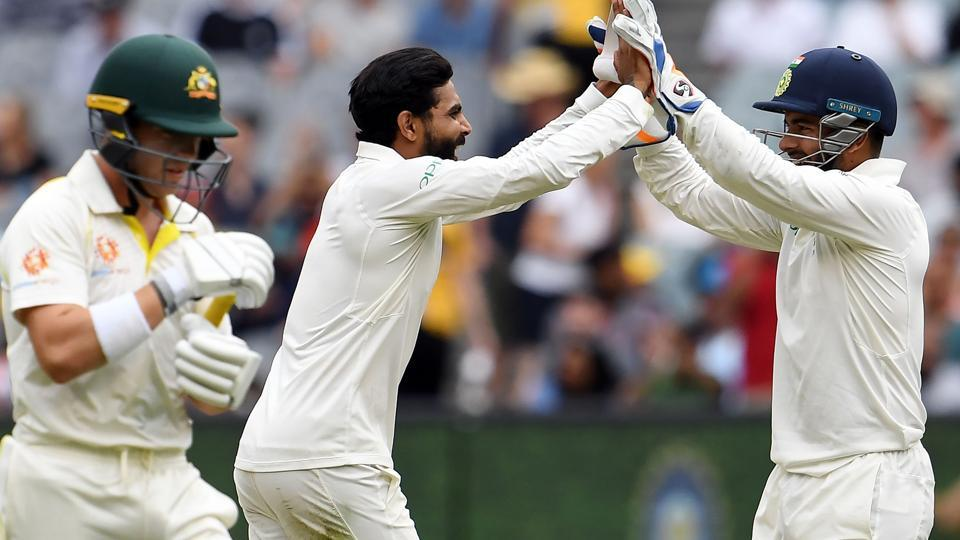 India's bowler Ravindra Jadeja (C) celebrates taking a wicket of Australia's batsman Marcus Harris (L) with teammate Rishabh Pant during day four of the third cricket Test match between Australia and India in Melbourne. (AFP)