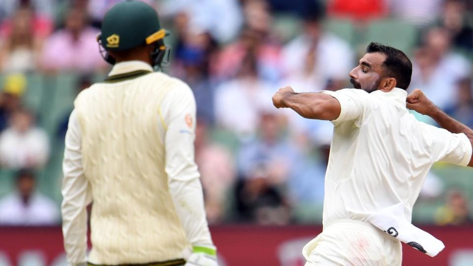 India's paceman Mohammed Shami (R) Jubilates after dismissing Australia's batsman Usman Khawaja (L) during day four of the third cricket Test match between Australia and India in Melbourne. (AFP)