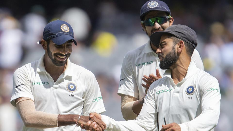 India's captain Virat Kohli, right, shakes hands with Jasprit Bumrah.