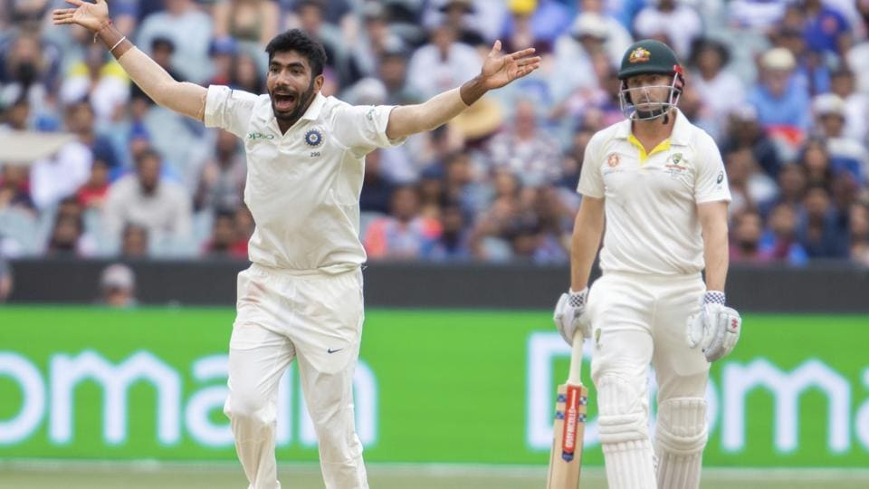 India's Jasprit Bumrah, left, appeals an LBW after bowling to Shaun Marsh during play on day four of the third cricket test between India and Australia in Melbourne. (AP)