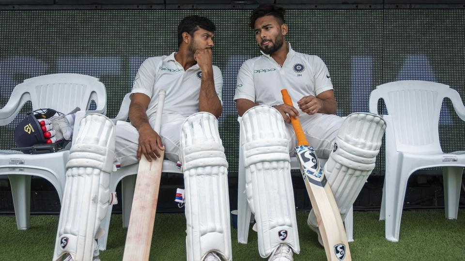 India's Mayank Agarwal, left, and Rishabh Pant sit on the bench before the start of play on day four of the third cricket test between India and Australia in Melbourne. (AP)