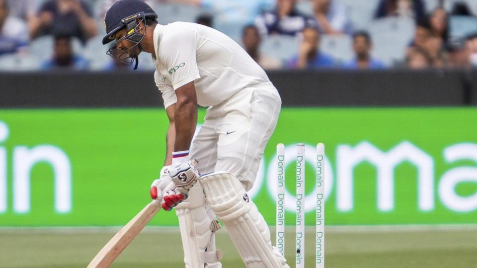 India's Mayank Agarwal gets bowled by Pat Cummins during play on day four of the third cricket test between India and Australia in Melbourne. (AP)