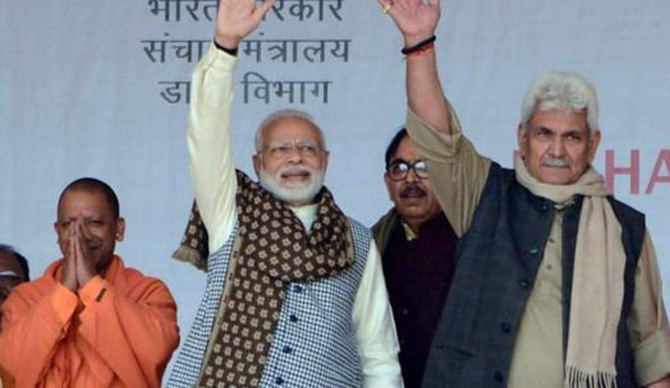 Prime Minister Narendra Modi flanked by MoS for Communications and Railways Manoj Sinha and Uttar Pradesh Chief Minister Yogi Adityanath during the foundation stone laying ceremony for a medical college, in Ghazipur, Saturday, Dec. 29, 2018.