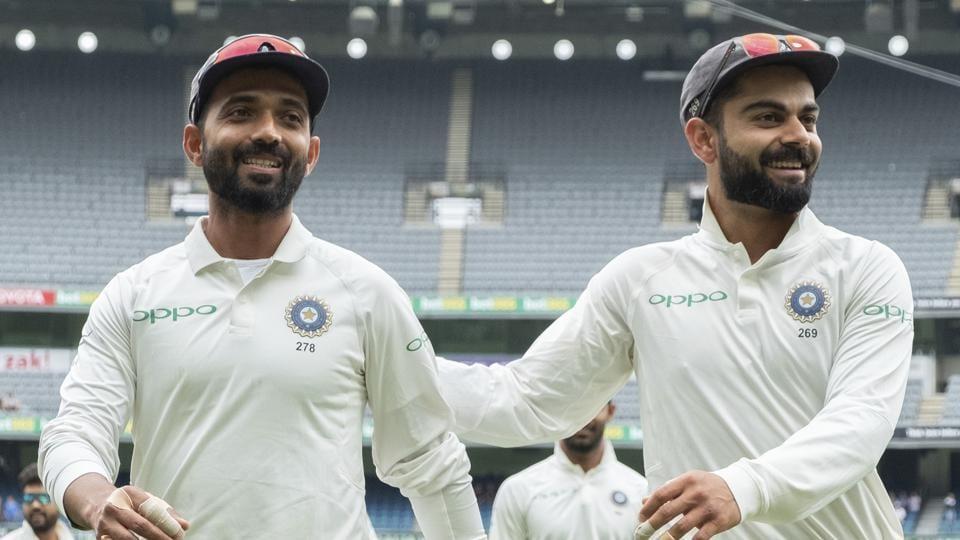 India's Ajinkya Rahane (left) and Virat Kohli walk off the field after the visitors beat Australia in the Melbourne Test.