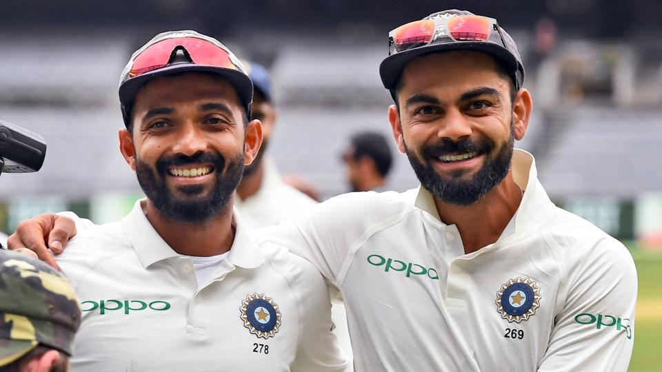 Virat Kohli (R) and Ajinkya Rahane (L) celebrate on the final day of the third Test match between Australia and India.