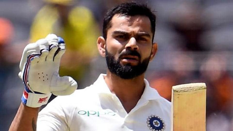 India's batsman Virat Kohli celebrates scoring his century.