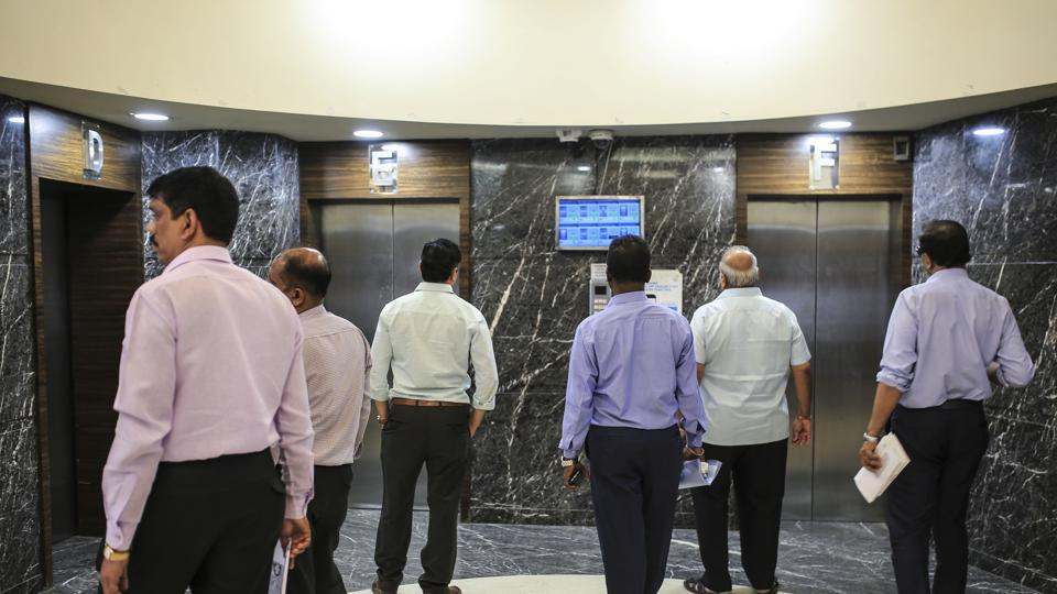 Visitors wait for elevators the Bombay Stock Exchange BSE building in Mumbai.