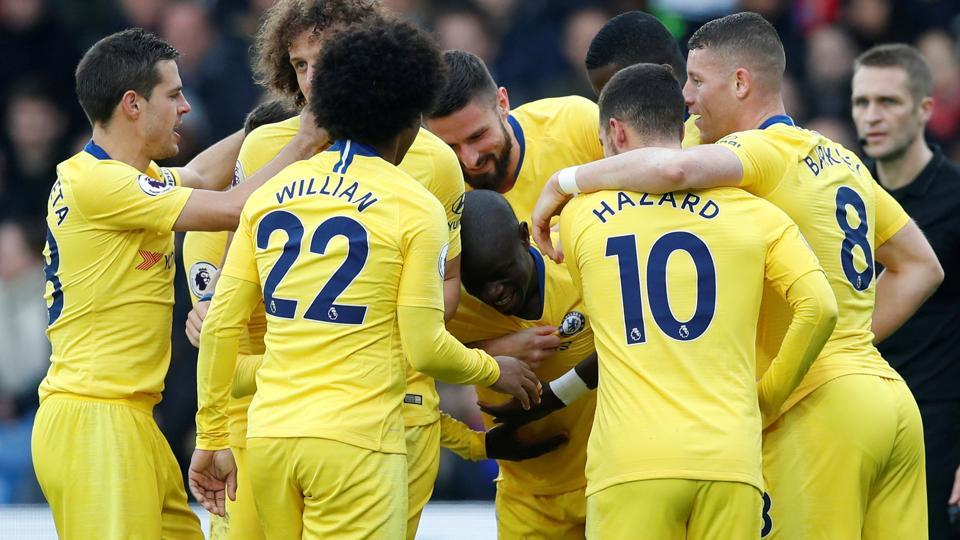 Chelsea's N'Golo Kante celebrates with team mates after scoring their first goal.