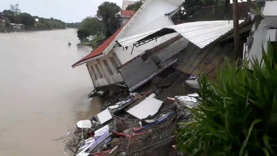 A destroyed house is seen after a tropical depression descended upon Daet, Camarines Norte, the Philippines.