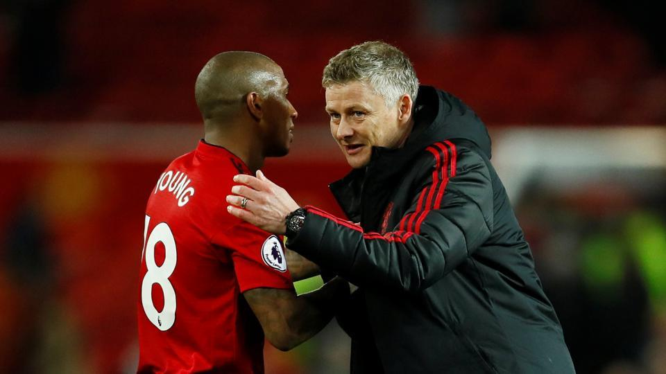 Manchester United interim manager Ole Gunnar Solskjaer celebrates with Ashley Young after the match against Bournemouth.