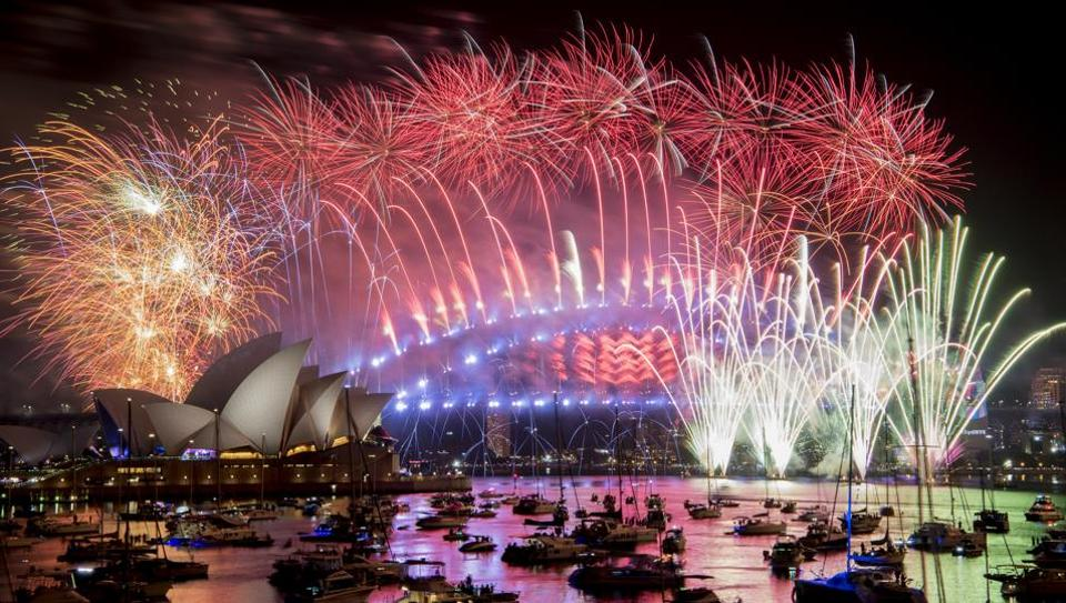 Australia's largest city Sydney put on its biggest-ever fireworks display in a spectacular welcome to the New Year, kicking off a wave of celebrations for billions around the world. (Brendan Esposito / AP Photo)
