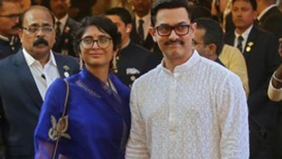 Bollywood actor Aamir Khan and his wife Kiran Rao arrive to attend the wedding of Isha Ambani.